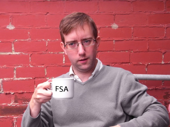 Edward Biddulph with a mug of tea with the letters FSA on it